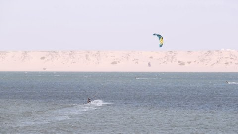 Seascape panorama with kiteboarding activity in the distance. Dakhla, Morocco