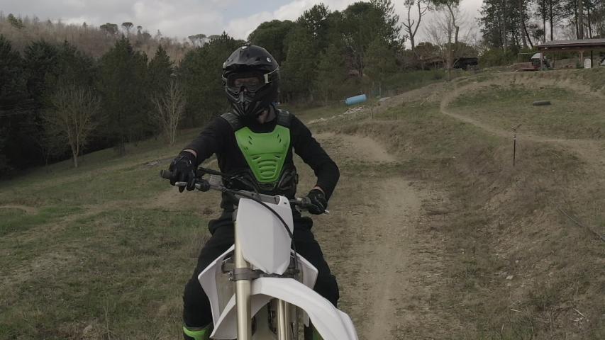 Motocross rider on a dirt track   Shutterstock HD Video #1030046402