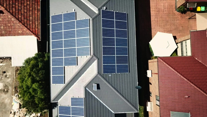 Solar panels on the roof of energy-efficient house. | Shutterstock HD Video #1030052402