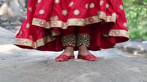 Indian girl wearing ghungroo practicing Kathak dance Outdoor