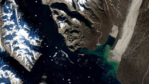 Winter scenic mountains satellite view sunrise animation, Greenland island. Contains public domain image by Nasa