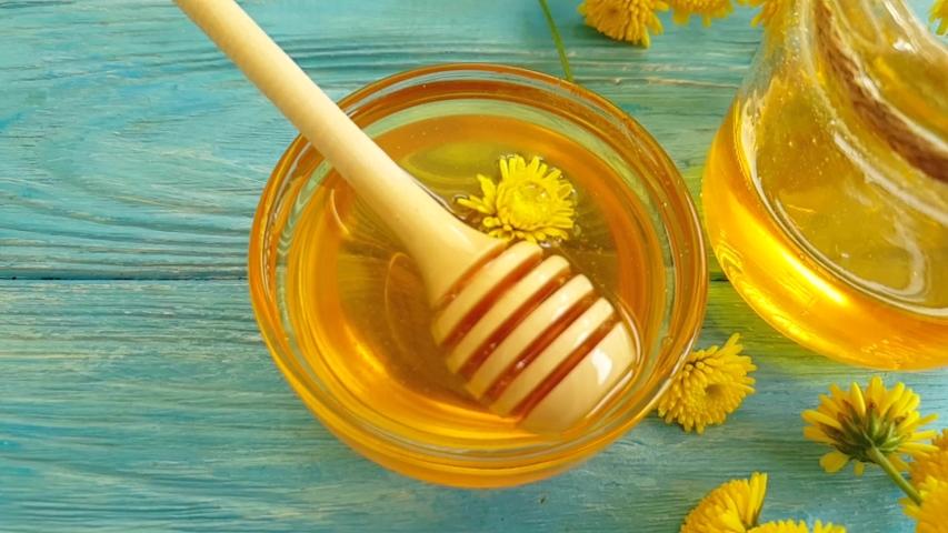 Fresh honey dandelion slow motion   Shutterstock HD Video #1030099622