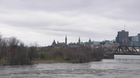 View of Parliament Hall over the flooded Ottawa River in 2019.