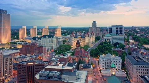 Drone footage of Albany, New York downtown at dusk, with pull back camera motion. Albany is the capital city of the U.S. state of New York and the county seat of Albany County