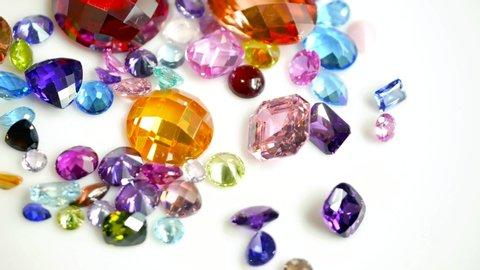 Jewel or gems on white shine table, Collection of many different natural gemstones amethyst, lapis lazuli, rose quartz, citrine, ruby, amazonite, moonstone, labradorite, chalcedony, blue topaz