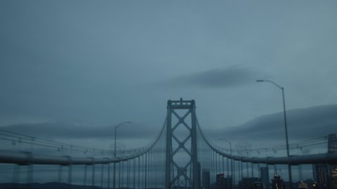 Driving Point of View of Bay Bridge in California on a cloudy, dark day. Shot on a Canon C200 in 4K in San Francisco in 2019.