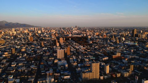 Sapporo city in early morning - Aerial higher altitude ascending view, Hokkaid?, Japan