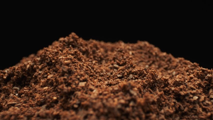 Ground Coffee And Single Coffee Bean. Isolated. Macro Shot. | Shutterstock HD Video #1030453562
