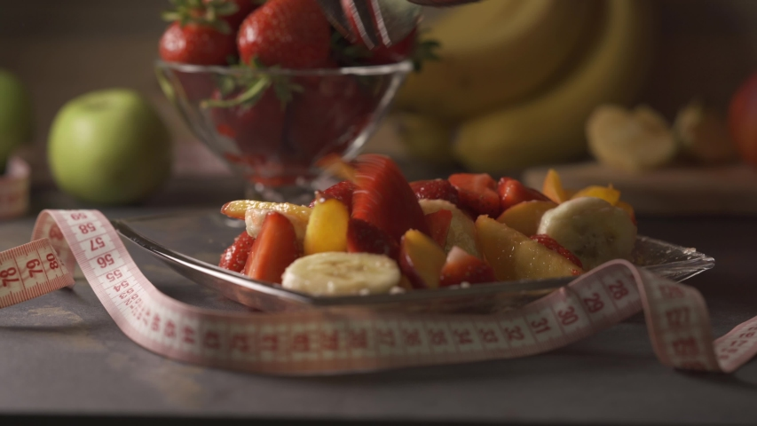 Weight Loss. Healthy and organic fruit salad. Concept of: fitness, diet, wellness and breakfast. Assorted coloful fruits. Home cooking.   Shutterstock HD Video #1030461362