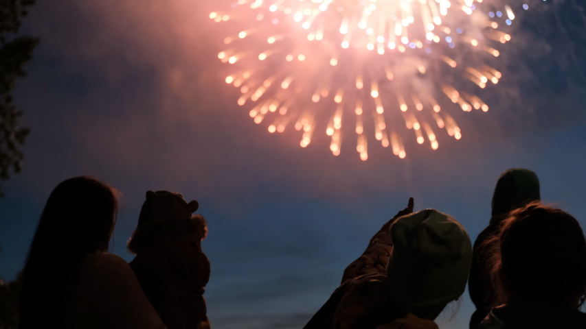 Children watching the fireworks and happily point the finger at flash. | Shutterstock HD Video #1030594472