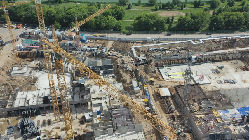 Aerial view of the construction of a residential quarter near the Park area #1030689122