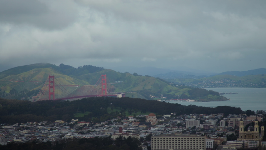 View of the Golden Gate Bridge in the distant on a cloudy, foggy, dark day in San Francisco. Shot on a Canon C200 in 4K in San Francisco in 2019.
