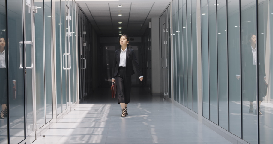 Funny asian businesswoman dancing in office hall, celebrating her achievement. Successful manager doing victory dance - way to success concept 4k | Shutterstock HD Video #1030788962