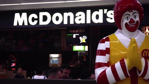THAILAND - MAY 15, 2019: Mascot of McDonald's Fast Food Restaurant Chain Clown Statue of Ronald McDonald Making Thai Greeting Sawasdee at International Airport in Bangkok