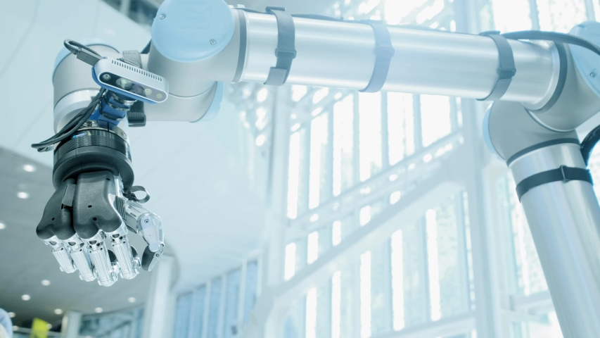 UFA/RUSSIA - 01.06.2019: Future today. Robotic arm shows like hand. A metal robot hand raises his thumb up. Modern technology robots. Bright scientific and technical office | Shutterstock HD Video #1030873652