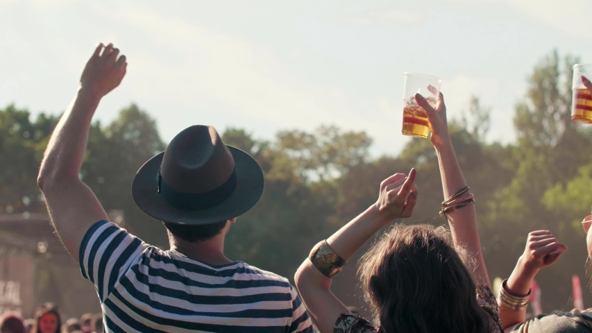 Rear view of people having good time in festival  | Shutterstock HD Video #1030935842