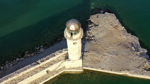 Aerial drone video of unique old picturesque Venetian lighthouse in the heart of famous city of Rethymno, Crete island, Greece