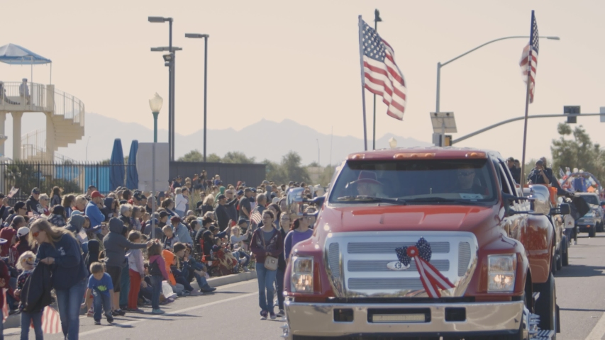Surprise, AZ / United States - 11 12 2018: Truck in a parade displaying American Flags   Shutterstock HD Video #1031018582