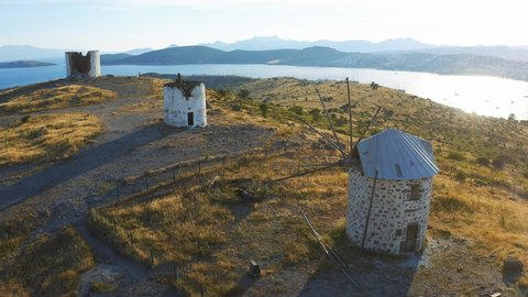 Old windmills on the hill in Bodrum, Turkey. Spectacular landscape at sunset. Welcome to Turkey concept 4k