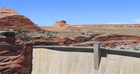 Glen Canyon Dam Lake Powell Arizona pan. Concrete arch gravity dam on the Colorado River in northern Arizona. Forms Lake Powell. Major source of hydroelectricity.