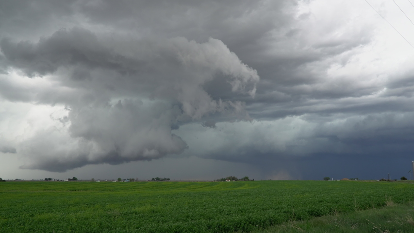 Storm clouds moving over the landscape during tornado warning in Eastern Colorado. | Shutterstock HD Video #1031220062