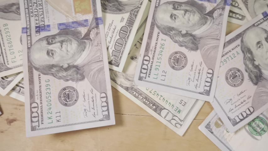 Money paying for bills. Images of the U.S. Dollar. Business finance and money concept. Save money for prepare in the future. Deadline and time is money concept with hourglass and US currency.