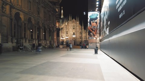 """Milan, Italy - May 2019: Milan Cathedral (Duomo di Milano}. It is by far the foremost tourist attraction of the city. Piazza del Duomo (""""Cathedral Square"""") is the main piazza (city square)"""