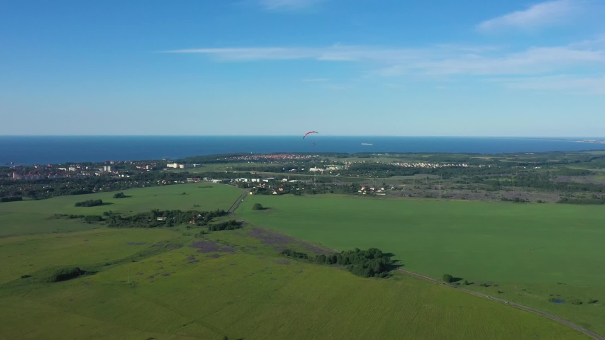 Aerial: The paraglider in the sky   Shutterstock HD Video #1031452442