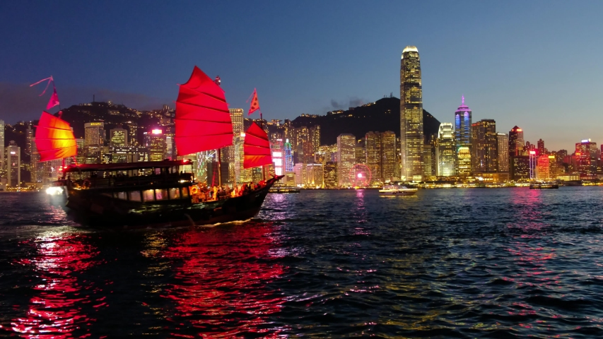 Hong Kong Skyline and Victoria Harbor. Hong Kong is one of the most densely populated city. | Shutterstock HD Video #1031484482