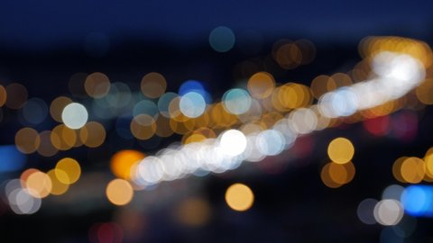 Colored lights in the city. Bokeh from car light on the traffic road.
