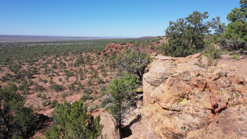 Aerial rural southern Utah desert cliff lizard. Kanab southwest landscape. Dry mountain valley red rock wilderness. Nature and recreation destination.  | Shutterstock HD Video #1031625002