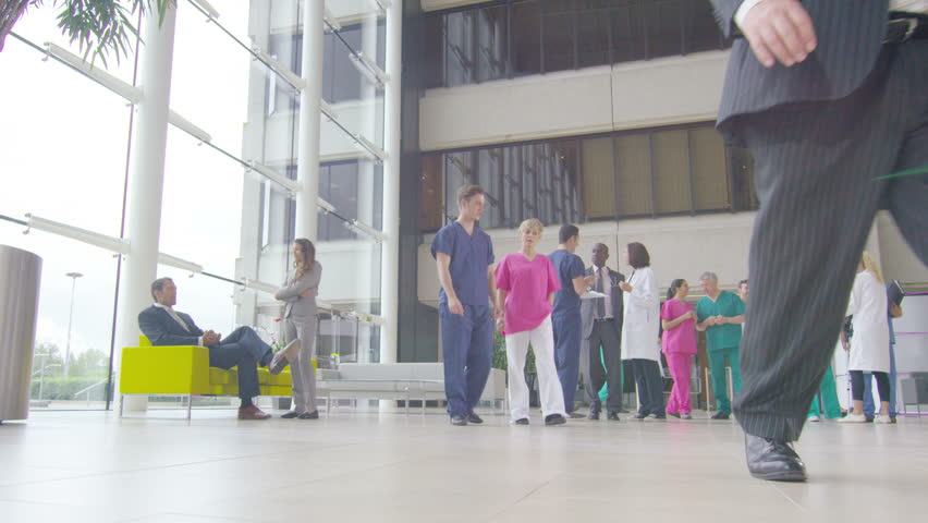 4K Time lapse of medical staff and patients in busy modern hospital