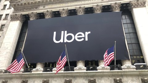 NEW YORK CITY - MAY 10, 2019: Uber Technologies Inc. (NYSE: UBER) becomes public company via initial public offering IPO New York Stock Exchange. Ride sharing transportation services Dara Khosrowshahi