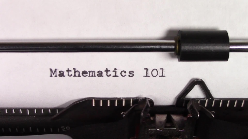 """A close up video of the words """"Mathematics 101 """" being typed on white paper in an old manual typewriter. Shot in macro.   Shutterstock HD Video #1031830472"""