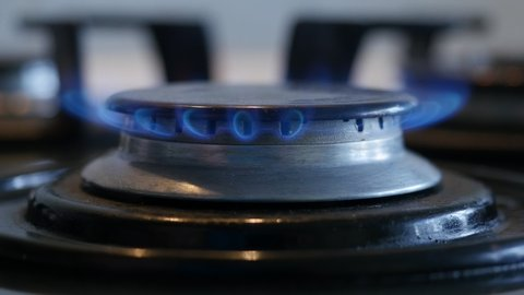 Close-up of turning on a kitchen gas stove, Natural gas inflammation in gas cooker, 4k shot