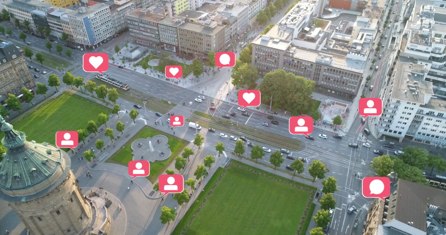 Social Media Marketing Concept Aerial View of Cityscape with pop up and out Social Media Like, Comment, Follower Icons | Shutterstock HD Video #1032010742