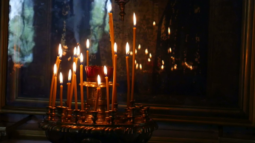 Burning candles in an Orthodox Church. Soft candlelight.   Shutterstock HD Video #1032022952