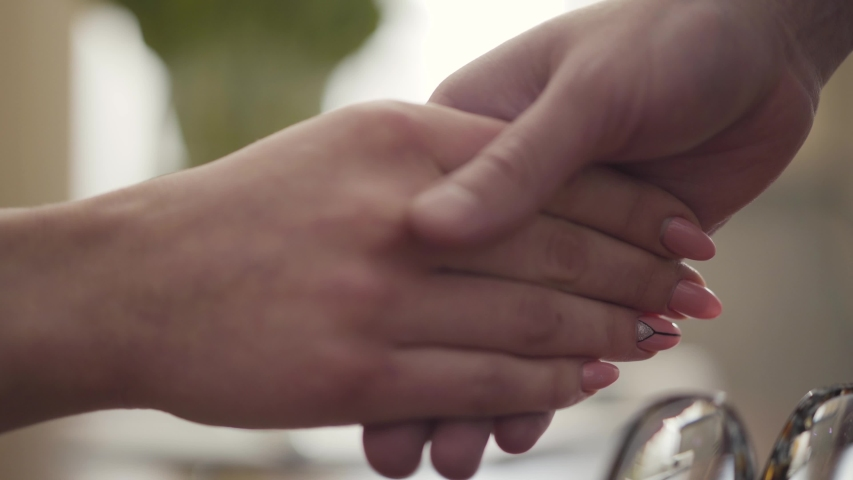The woman and teenager shaking hands close-up. Tender female hand holding palm of the kid. Female psychologist with her teen patient | Shutterstock HD Video #1032078572