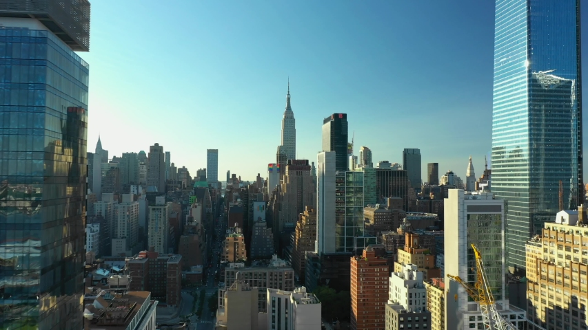 NEW YORK, NY, USA - JUNE 21, 2019: Aerial approach The Newyorker and Empire State Building