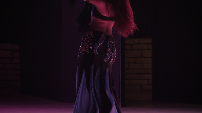 Emotional view of a stylish and slender woman dancing an Arabic dance in a Turkish restaurant circling originally in slow motion. | Shutterstock HD Video #1032171332