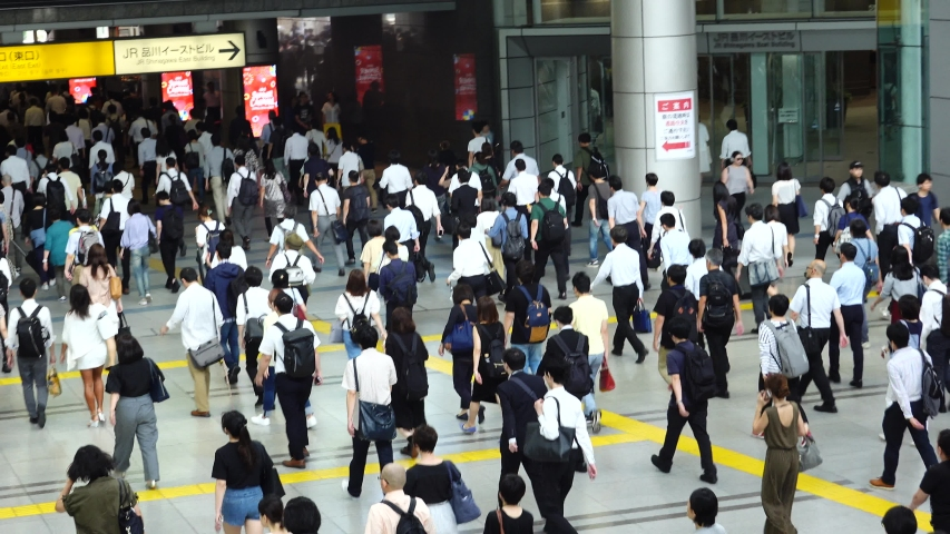 June 28, 2019, Tokyo, Japan, busy commuters rushing to work at Shinagawa station in Tokyo Japan. Tokyo will be the host city for the 2020 Summer Olympics and Para Olympics. | Shutterstock HD Video #1032181052
