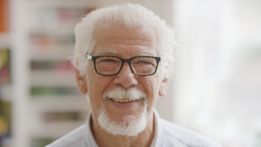 Portrait of handsome senior man looking to camera and smiling    Shutterstock HD Video #1032397082
