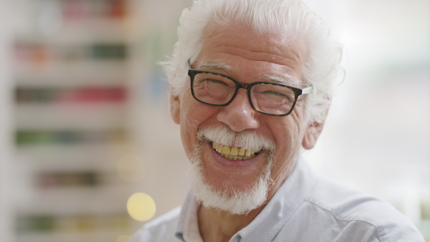 Senior man reacts and laughs to camera, in slow motion   Shutterstock HD Video #1032404852
