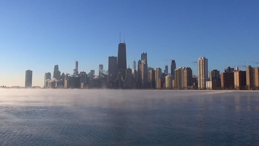 Sea smoke on Lake Michigan with Chicago skyline in the morning sunlight during a polar vortex 4k