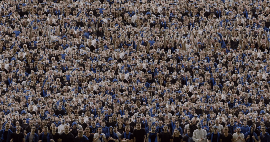 MODEL RELEASED Front view sports crowd fans wearing blue clothes celebrating during a sport event. Green screen crowd replication | Shutterstock HD Video #1032591602