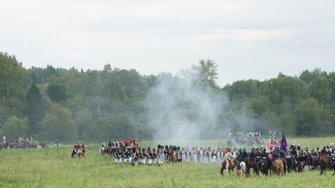 Borodino, russia - september 02, 2017 - reenactment of the battle of  borodino the patriotic war of 1812 year   tourists watch the performance  from from the fenced places