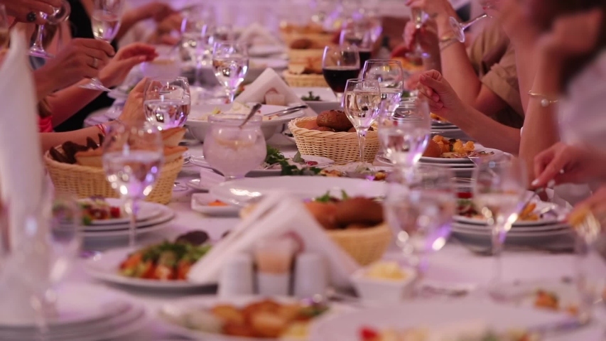 Guests enjoy sitting at festive table and celebrating birthday clink glasses with white wine slow motion close view | Shutterstock HD Video #1032803072