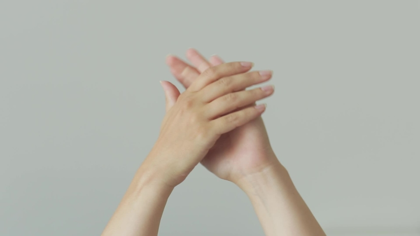 Woman hands clapping applause over gray background.  | Shutterstock HD Video #1033105112