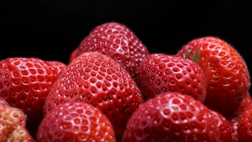 Strawberries on black background. Rotation 360 degrees, closeup.  | Shutterstock HD Video #1033159712