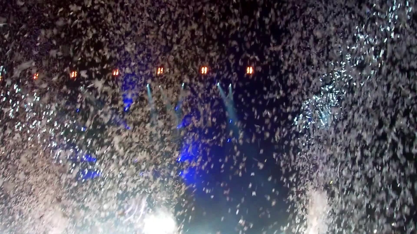 White confetti floating in the air during a concert | Shutterstock HD Video #1033210232